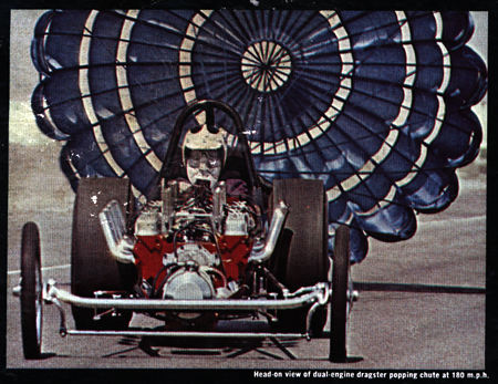 Head-on view of dual-engine dragster popping chute at 180 m.p.h. - Back cover album photo from the T-Bones : Boss Drag LP